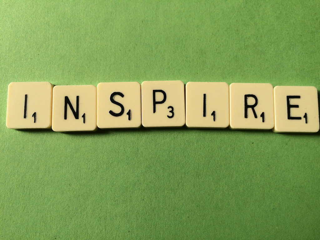 Inspire spelled with scrabble pieces