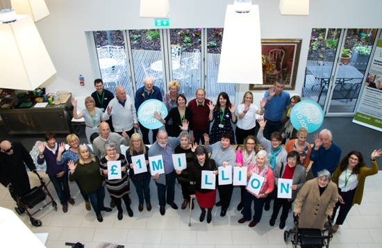 Guests attending a recent Arthur Rank Hospice Open Day gather for a photo to help share the news that Your Hospice Lottery has nearly raised £1 million for the Charity.