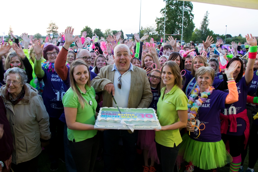 Cliff Parisi cuts the birthday cake – kindly donated by Regency Cakes - at what was the Arthur Rank Hospice's 10th annual memory walk.