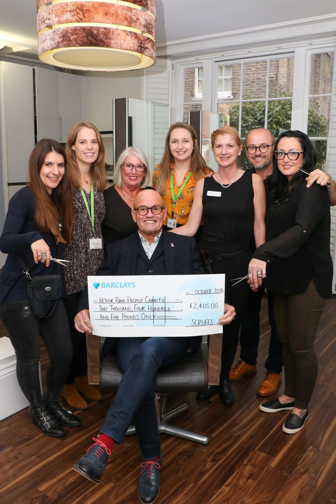 The team at Scruffs Hair Salon on Bridge Street, recently presented Arthur Rank Hospice with a cheque for £2405, after choosing to raise funds for them and another charity as part of their 50th Birthday Celebrations earlier this year. Left to right: Lily Barrett (Principal Stylist, Scruffs), Aisha Graves (Community Fundraiser, Arthur Rank Hospice Charity), Marilyn Chapman (Trainer, Scruffs), John Chapman (Founder, Scruffs), Bec Beattie (Community Fundraiser, Arthur Rank Hospice Charity), Karen Boon (Specialist Stylist, Scruffs), Garry Chapman (Director, Scruffs) and Charlotte Walker-Harding (Creative Stylist, Scruffs).